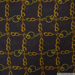 Mousseline polyester imprimée chainettes fond marron