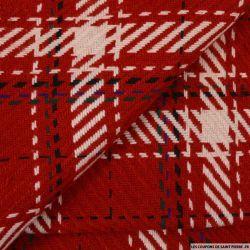 Lainage à carreaux rouge, noir et blanc